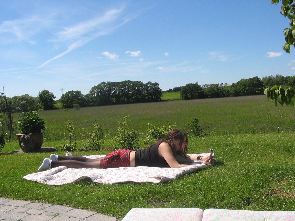 Leah lying on blanket in the garden 2005